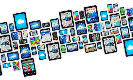 Group of tablet computer PC and modern touchscreen smartphones or mobile phones with colorful display screen interfaces with icons and buttons isolated on white background